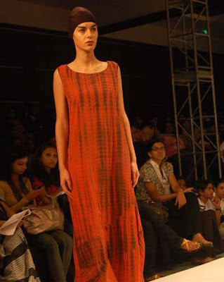 A model displays a creation by designer Kallol Datta during the Day 2 of 'Kolkata Fashion week II' on September 10, 2009.