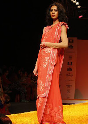Tina Chatwal walks on ramp