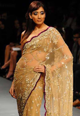 Binal Trivedi walks on ramp during LFW