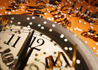 Picture of clock, confetti, New Year's