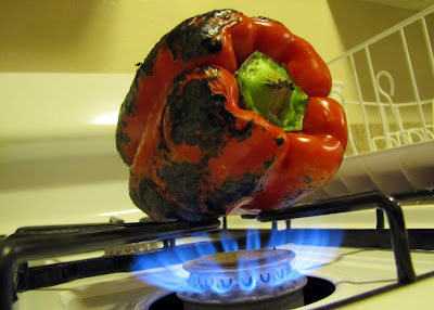Red+bell+pepper+rotated+over+flame