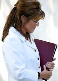 Palin in prayer before a speech.