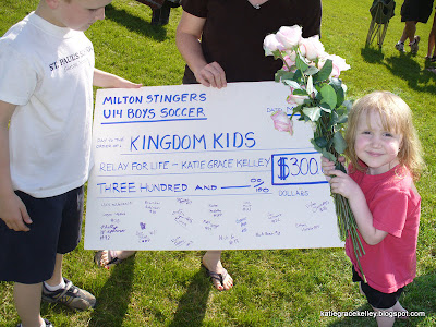 Katie, Amy, and Josh posing with the giant check donating $300 to the Relay for Life in Katie's name