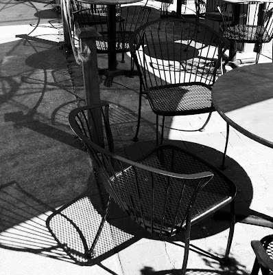 empty+wire+chairs+at+Nicoles Food for Thought  photo