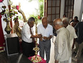 lighting of oil lamp by family members of martin wiremasinghe