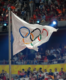 Olympic flag fluttering at the Beijing closng ceremony