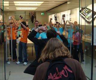 First customers going through the door of Belfast's new Apple Store