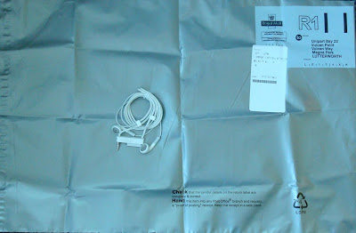 Enormous A3+ sized prepaid envelope to reutn tiny lanyard earphones to Apple