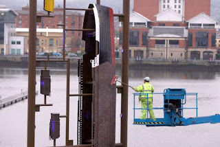A workman puts the finishing touches to a giant toy modelling kit of the Titanic on the site where the doomed liner was built almost a century ago in Belfast. PRESS ASSOCIATION Photo. Picture date: Thursday October 29, 2009. One hundred years after Belfast's ship builders put together the original vessel, scale replicas of its component parts have now returned to docks in the form of an innovative public artwork. See PA story ULSTER Titanic. Photo credit should read: Paul Faith/PA Wire
