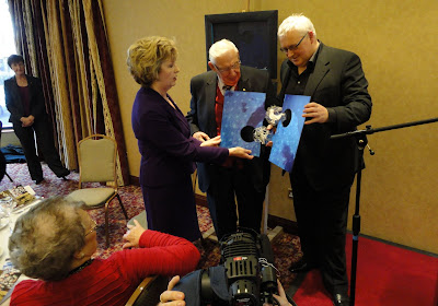 Artist Ian Fleming helping Irish President Mary McAleese and Lord Bannside (Ian Paisley) to piece together the two halves of their artworks at the Ullans Acamedy Columbanus Celebration