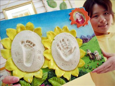 footprints tattoos. Baby footprints tattooed on