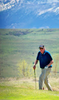 Western Novel Author Stephen Bly playing golf in desert