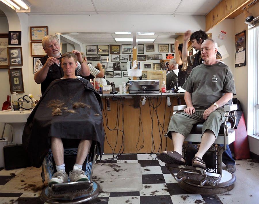 ... , John noticed an intriguing barber shop next to a Victorian tavern