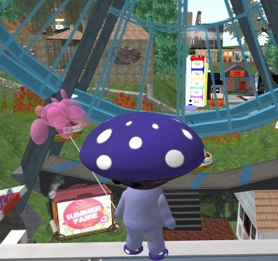 A small mushroom avatar holds a pink balloon and stands in front of a fun fair.