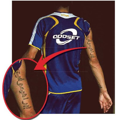 Marco Materazzi with a full tribal tattoos on arm tattoos, and hand tattoos