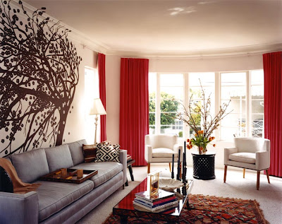 Design+living+room+grey+sofa+couch+red+drapes+curtains+brown+tree