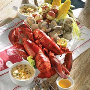 traditional New England Clam Bake with Maine lobsters, clams and ...