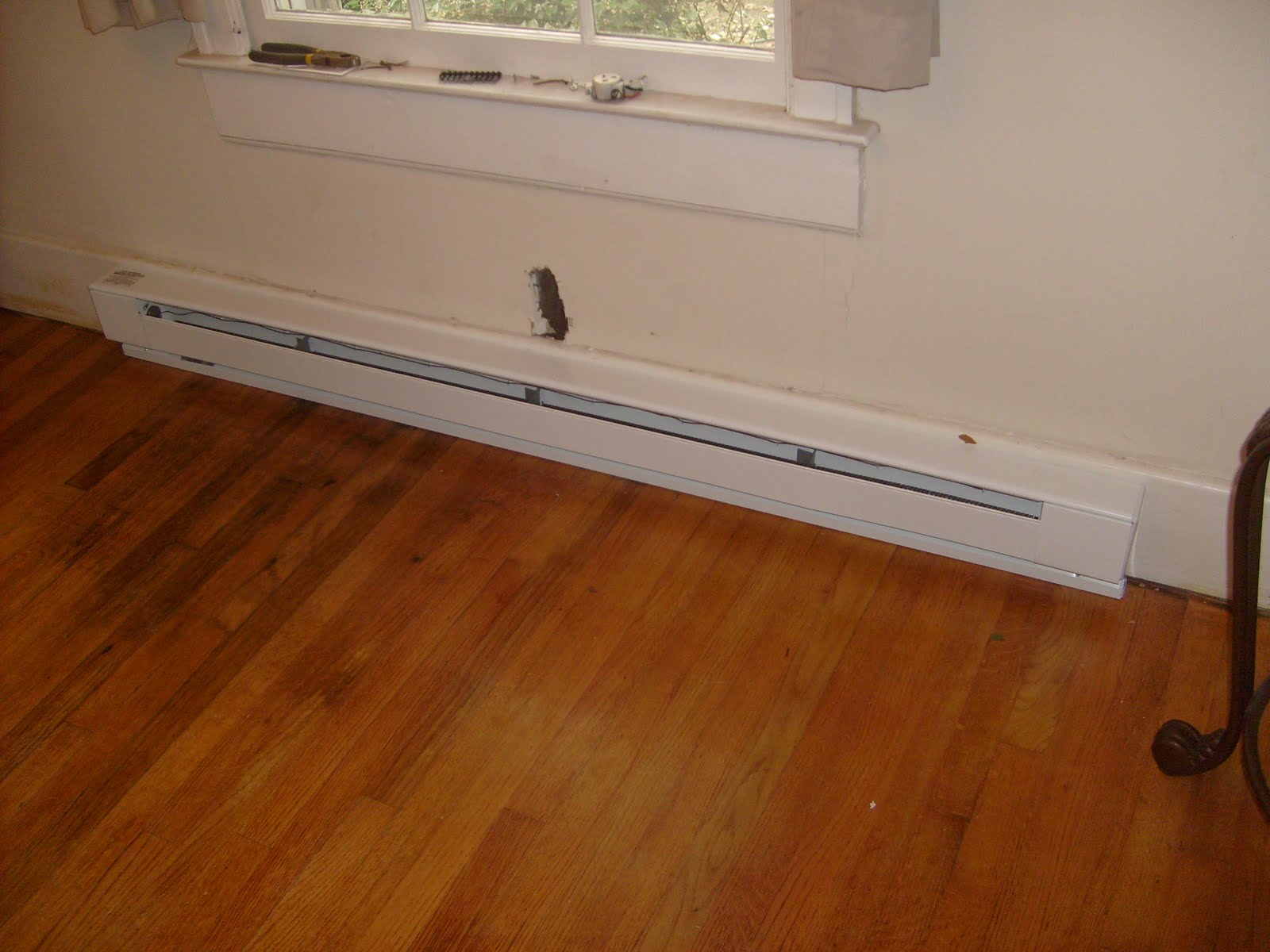 Help me fix it installing a baseboard heater and remote for Cost to paint baseboard