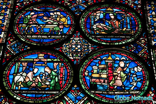stained glass window illustrating the miracle performed by Thomas Becket