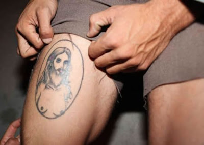 Jesus with boobs tattoo. really.