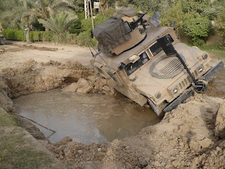 Humvee holding on for dear life!