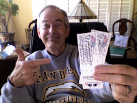 Tom holding his tickets for the Chargers-Patriots game next Sunday