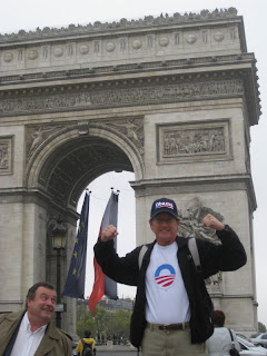 Paul celebrating the Obama victory at the Arc de Triomphe in Paris