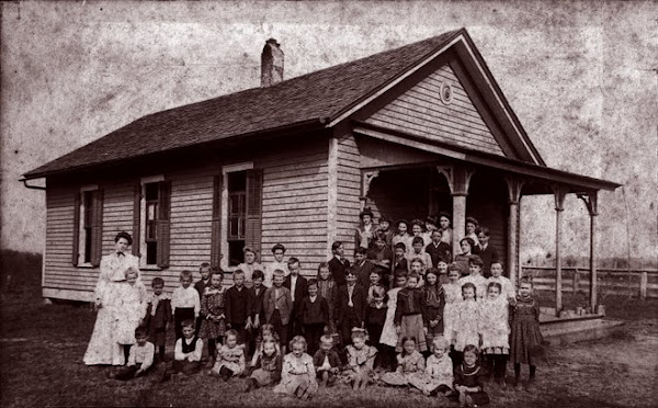"Guy, Mary & Bess in front of their one room schoolhouse, ""The Blakeley School""."