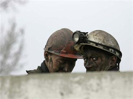 mineiros num funeral
