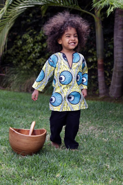 little boy in African print shirt