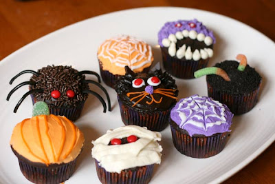not too bad for my first batch of halloween inspired cupcakes spiders were the big hit of the night - Halloween Inspired Cupcakes