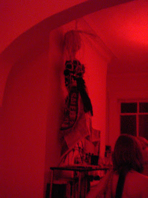 witch made out of sticks and paper propped up on a mantel