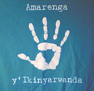 white on green silkscreen; a handprint is in the middle with amarenga above adn y'ikinyarwanda below