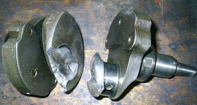 A crankshaft broken at the front of the number one crank pin
