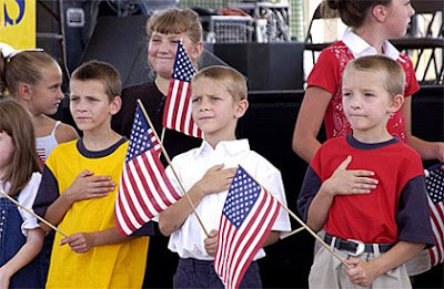 Children of military personnel in the Peoria, Ill., area lead the audience in the Pledge of Allegiance during the opening of Operation Enduring Families held on the Peoria river front, Sept. 11, 2004. Operation Enduring Families was a showcase event to commemorate military members and the victims of the attacks of Sept. 11, 2001. U.S. Air Force photo by Master Sgt. John Walker
