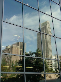 [Reflective view of the First national Bank Tower]