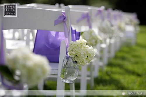 Hydrangeas frame this wedding aisle beautifully for an outdoor wedding