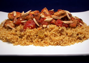 Moroccan Chicken over Couscous with Almonds and Currants