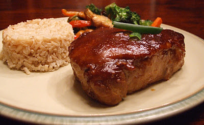These are Hoisin and Honey Glazed Pork Chops - modified from Gourmet .