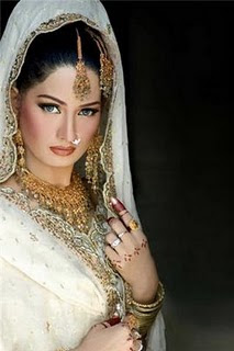 Cute Pakistani Model in a White Bridal Dress with Naughty Look