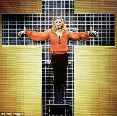 Madonna in her controversial singing in a cross
