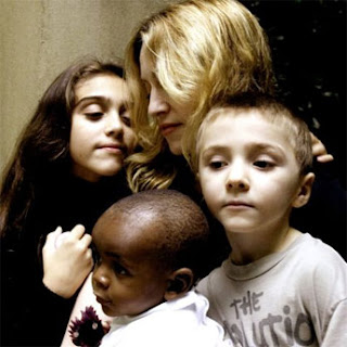 Madonna with kids and adopted african