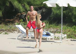 Nicollette Sheridan in red bikini spends Xmas day