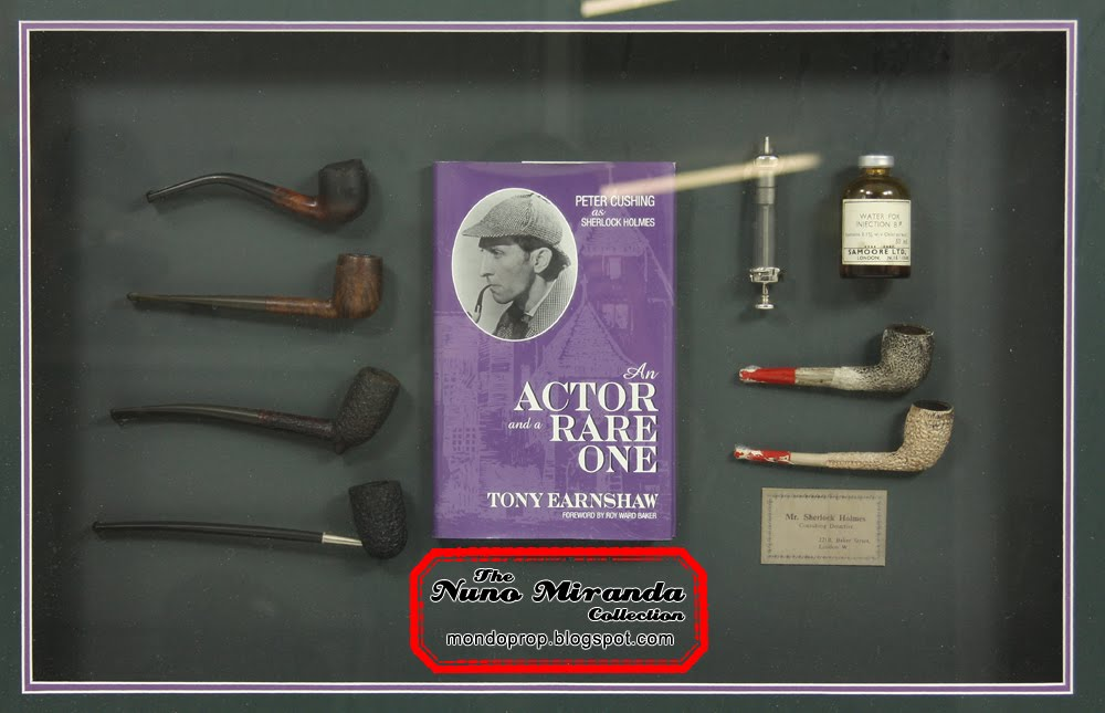 "This is a set of six pipes, a ""Sherlock Holmes"" calling card and syringe"