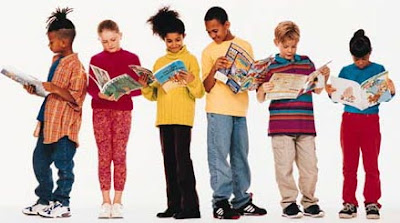 six brightly dressed children in a row reading books
