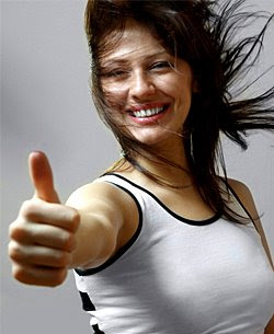 smiling woman with thumb up