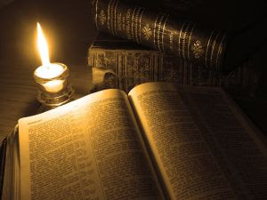 Open bible in candle light