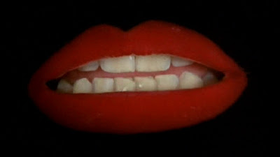 close up of large red lips from Rock Horror Picture Show