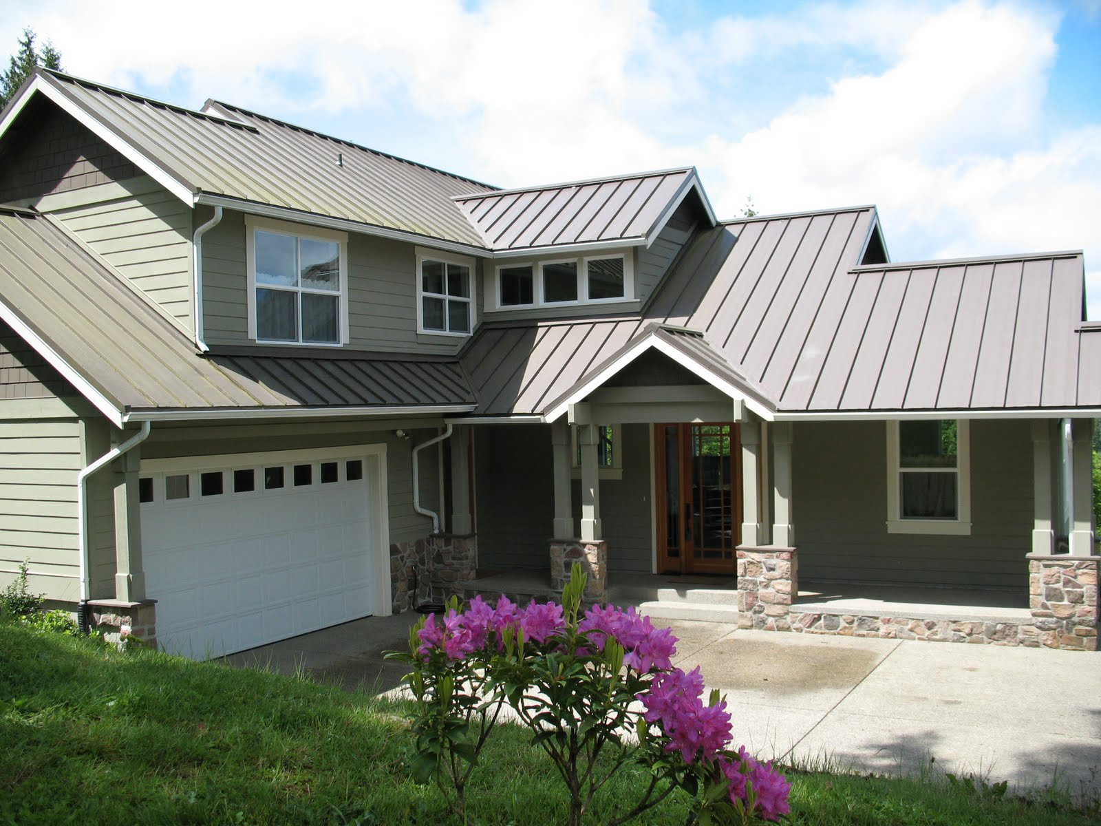 Tin roof house plans over 5000 house plans for Images of houses with metal roofs