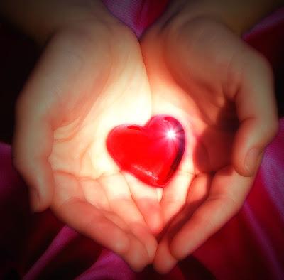 Heart symbol held on hands.